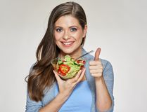 Smiling woman holding salad dish show thumb up. Female isolated portrait Stock Photos