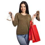 Smiling woman holding a shoe, a necklace, and red shopping bags Royalty Free Stock Photo