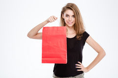 Smiling woman holding shopping bag Royalty Free Stock Photography
