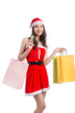 Smiling woman holding shopping bags before christmas showing cre. Dit card Stock Image