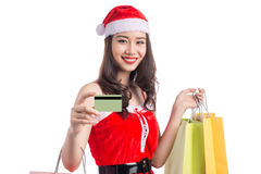 Smiling woman holding shopping bags before christmas showing cre. Dit card. Focus on card Royalty Free Stock Photography