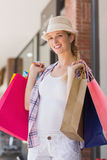 Smiling woman holding shopping bags Stock Photography