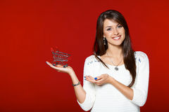 Smiling woman holding shopping cart Royalty Free Stock Photo