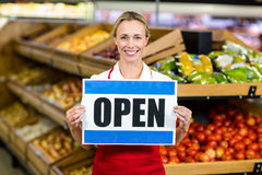 Smiling woman holding sign Royalty Free Stock Photos