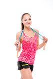 Smiling woman holding skipping rope. Portrait of a smiling woman holding skipping rope and looking at camera isolated on a white background Stock Images