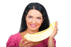 Smiling woman holding a slice of melon Stock Photos