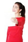Smiling woman holding small blank banner Stock Photography