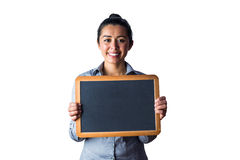 Smiling woman holding a small chalkboard Royalty Free Stock Image