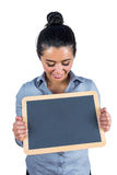 Smiling woman holding a small chalkboard Royalty Free Stock Photo
