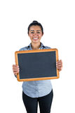 Smiling woman holding a small chalkboard Royalty Free Stock Photos