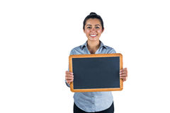 Smiling woman holding a small chalkboard Stock Photo