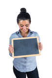 Smiling woman holding a small chalkboard Stock Photos