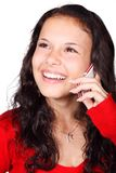 Smiling Woman Holding Smartphone Royalty Free Stock Photography
