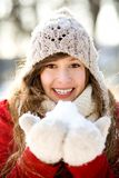 Smiling woman holding snow Royalty Free Stock Photos