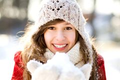 Smiling woman holding snow Stock Images
