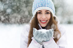 Smiling woman holding snow Stock Photo