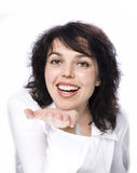 Smiling woman holding something Royalty Free Stock Photography
