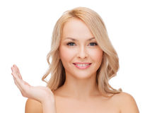 Smiling woman holding something imaginary Stock Images