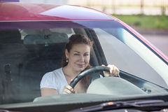Smiling woman holding steering wheel Stock Photography