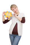 Smiling woman holding sunny toy Royalty Free Stock Photos
