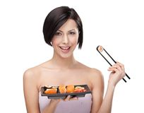Smiling woman holding sushi roll Royalty Free Stock Photography