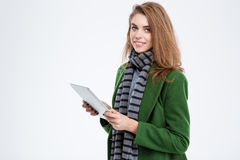 Smiling woman holding tablet computer Royalty Free Stock Photography