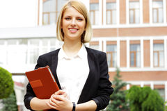 Smiling woman holding tablet computer Stock Images