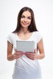 Smiling woman holding tablet computer Stock Photography