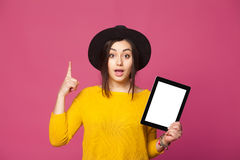 Smiling woman holding tablet having new idea Stock Image