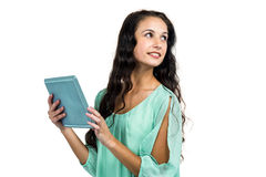 Smiling woman holding tablet and looking away Royalty Free Stock Photo