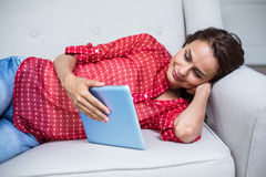 Smiling woman holding tablet Royalty Free Stock Photos