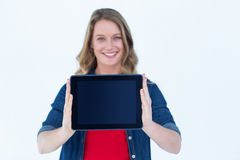 Smiling woman holding tablet pc Stock Images
