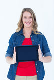 Smiling woman holding tablet pc Stock Image