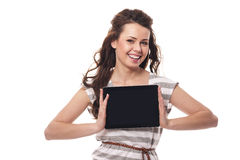 Smiling woman holding tablet Royalty Free Stock Images