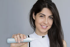 Smiling woman holding toothbrush with black  charcoal  toothpaste. Woman holding toothbrush with toothpaste with charcoal for dental whitening Stock Photo