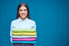 Smiling woman holding towels, room service. Stock Photography