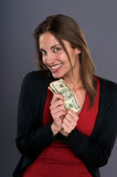 Smiling Woman Holding Twenties Royalty Free Stock Photo