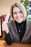 Smiling woman holding two credit cards Royalty Free Stock Images
