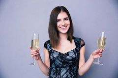 Smiling woman holding two glass of champagne Stock Photo