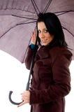 Smiling woman holding umbrella on white background Stock Photo