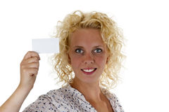 Smiling woman holding up a blank business card Stock Image