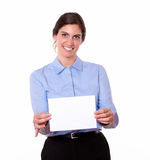 Smiling woman holding up a blank white card Royalty Free Stock Photo