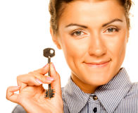 Smiling woman holding up a key Stock Image