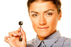 Smiling woman holding up a key stock images