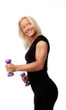 Smiling woman holding weights Royalty Free Stock Photography