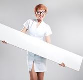 Smiling woman holding white board royalty free stock images