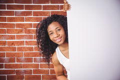 Smiling woman holding white board Stock Photography