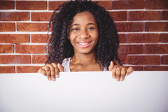 Smiling woman holding white board Royalty Free Stock Photography