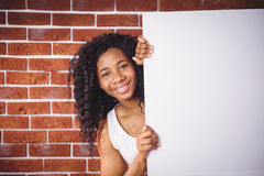 Smiling woman holding white board Stock Image