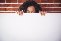 Smiling woman holding white board Royalty Free Stock Image